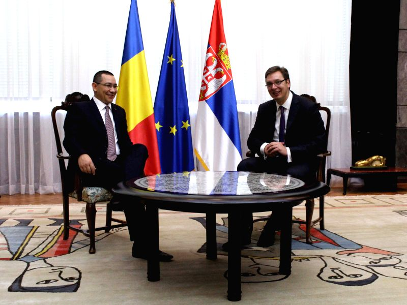 Romanian Prime Minister Victor Ponta (L) meets with his Serbian counterpart Aleksandar Vucic in Belgrade, Serbia, on July 17, 2014. Victor Ponta voiced support to .