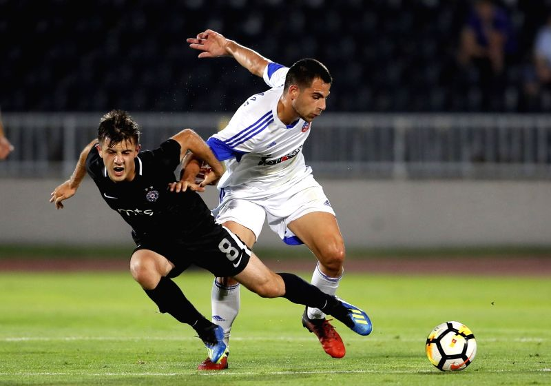 BELGRADE, July 20, 2018 - Partizan's Armin Djerlek (L) vies with Rudar's Dejan Kotorac during the first qualifying round UEFA Europa League football match between Partizan and Rudar in Belgrade, ...