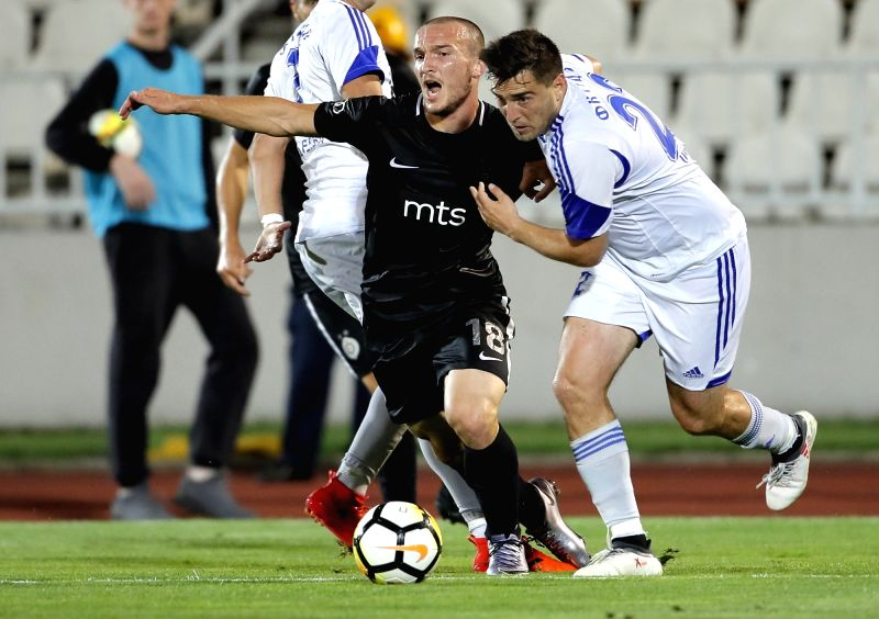 BELGRADE, July 20, 2018 - Partizan's Djordje Ivanovic (L) vies with Rudar's Zeljko Tomasevic during the first qualifying round UEFA Europa League football match between Partizan and Rudar in ...