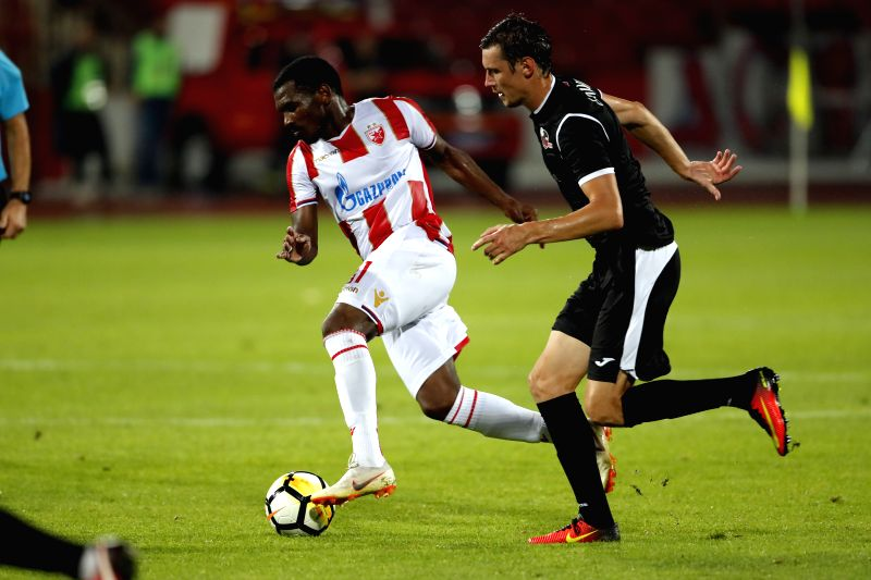 BELGRADE, July 25, 2018 - Crvena Zvezda's El Fardou Ben Nabouhane (L) vies with Suduva's Povilas Leimonas during the UEFA Champions League second qualifying round football match in Belgrade, Serbia ...