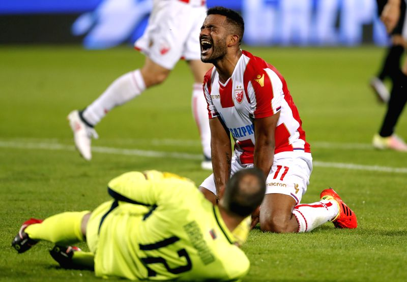 BELGRADE, July 25, 2018 - Crvena Zvezda's Lorenzo Ebecilio (R) reacts during the UEFA Champions League second qualifying round football match between Crvena Zvezda and Suduva in Belgrade, Serbia on ...