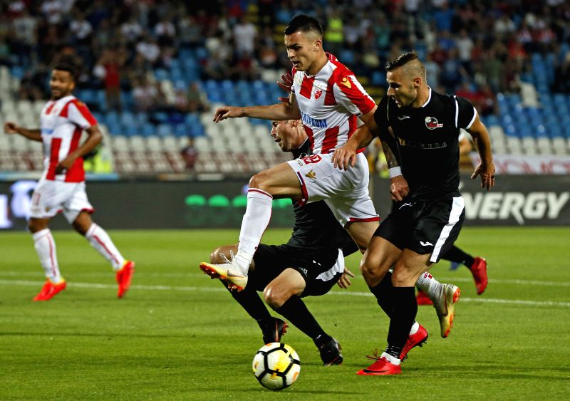 BELGRADE, July 25, 2018 - Crvena Zvezda's Nemanja Radonjic (2nd R) vies with Suduva's Andro Svrljuga (1st R) during the UEFA Champions League second qualifying round football match between Crvena ...