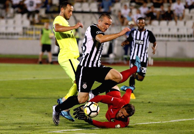 BELGRADE, July 27, 2018 - Partizan's Djordje Ivanovic (C) vies with Trakai's goalkeeper Tomas Svedkauskas (Bottom) during the second qualifying round UEFA Europa League football match in Belgrade, ...