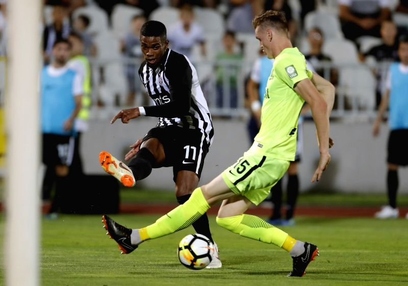 BELGRADE, July 27, 2018 - Partizan's Ricardo Gomes (L) shoots the ball past Trakai's Justinas Janusevskis during the second qualifying round UEFA Europa League football match in Belgrade, Serbia, ...