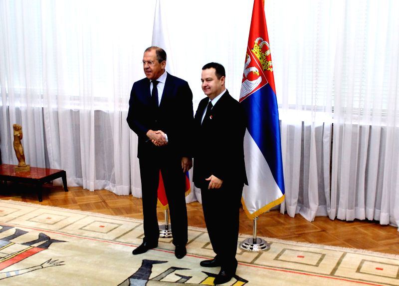 Russian Foreign Minister Sergey Lavrov (L) shakes hands with his Serbian counterpart Ivica Dacic before their meeting in Belgrade, Serbia on June 17, 2014. Sergey .