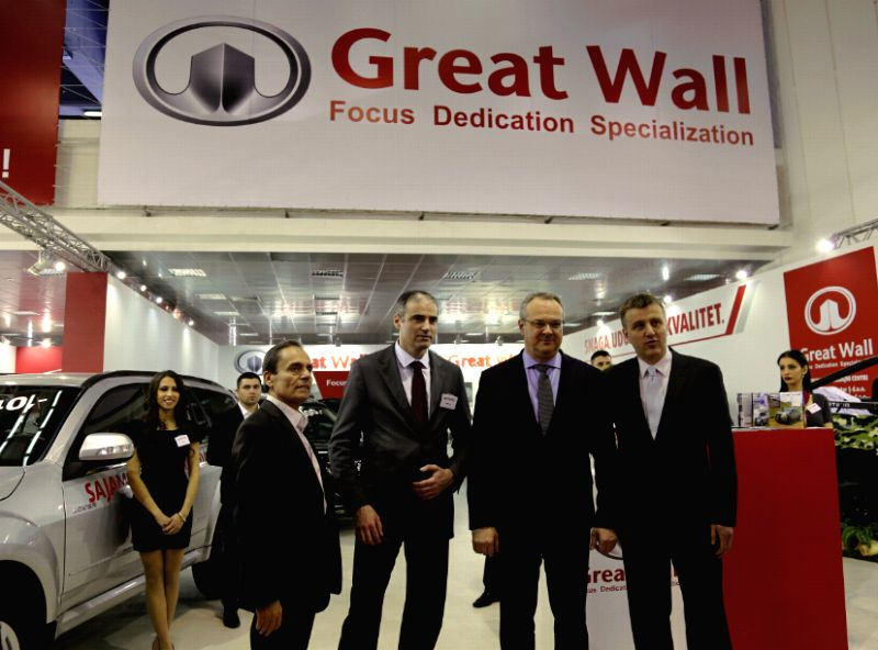 Serbian Minister of Economy Zeljko Sertic (2nd R) visits the stand of China's Great Wall Motors at the 52nd International Motor Show in Belgrade, Serbia, on March ...
