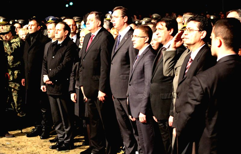 Serbian state officials take part in a ceremony marking the 16th anniversary of the NATO bombing in Belgrade, Serbia, on March 24, 2015. A ceremony to mark the ...
