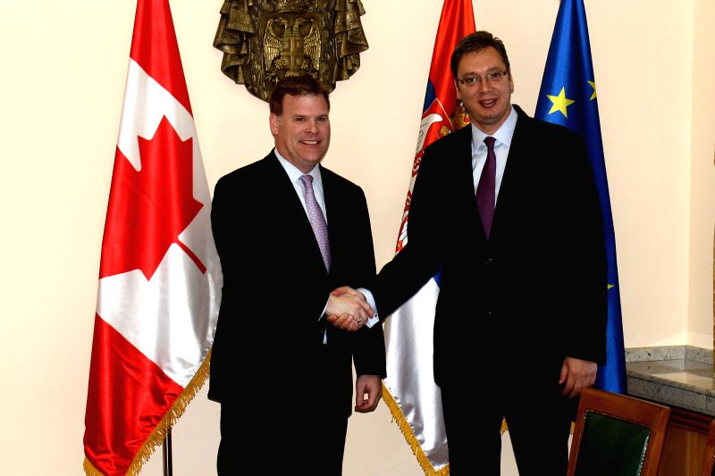 Canadian Foreign Minister John Baird (L) shakes hands with Serbian Prime Minister Aleksandar Vucic at the building of the Serbian government in Belgrade on Sept. .
