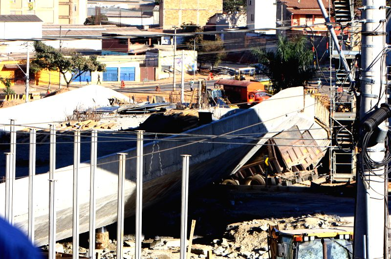 This picture taken on July 4, 2014 shows the view of the site of the collapse of an overpass under construction in Belo Horizonte city, Brazil. According to ..