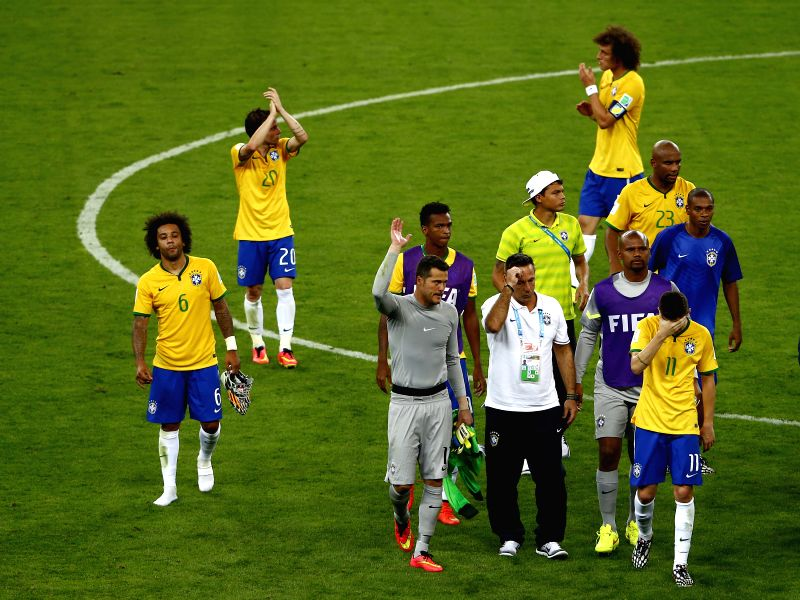 Brazil's players applaud their fans after a semifinal match between Brazil and Germany of 2014 FIFA World Cup at the Estadio Mineirao Stadium in Belo ...