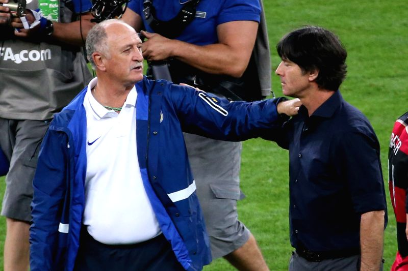 Brazil's coach Luiz Felipe Scolari (L) greets Germany's coach Joachim Loew after a semifinal match between Brazil and Germany of 2014 FIFA World Cup at the ...