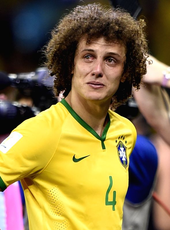 Brazil's David Luiz looks on with tears after a semifinal match between Brazil and Germany of 2014 FIFA World Cup at the Estadio Mineirao Stadium in Belo ...