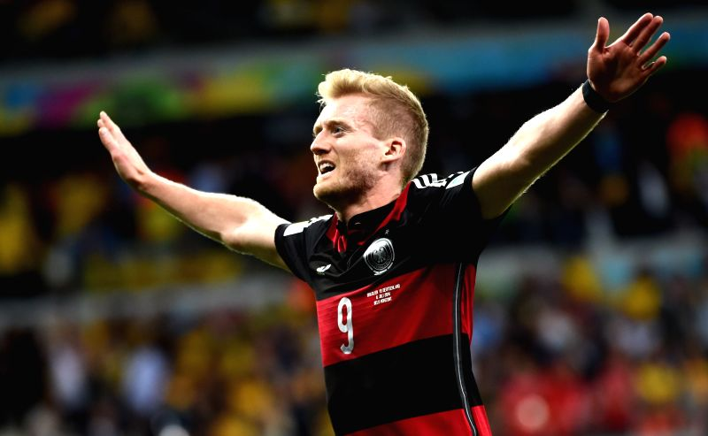 Germany's Andre Schuerrle celebrates after scoring during a semifinal match between Brazil and Germany of 2014 FIFA World Cup at the Estadio Mineirao Stadium .