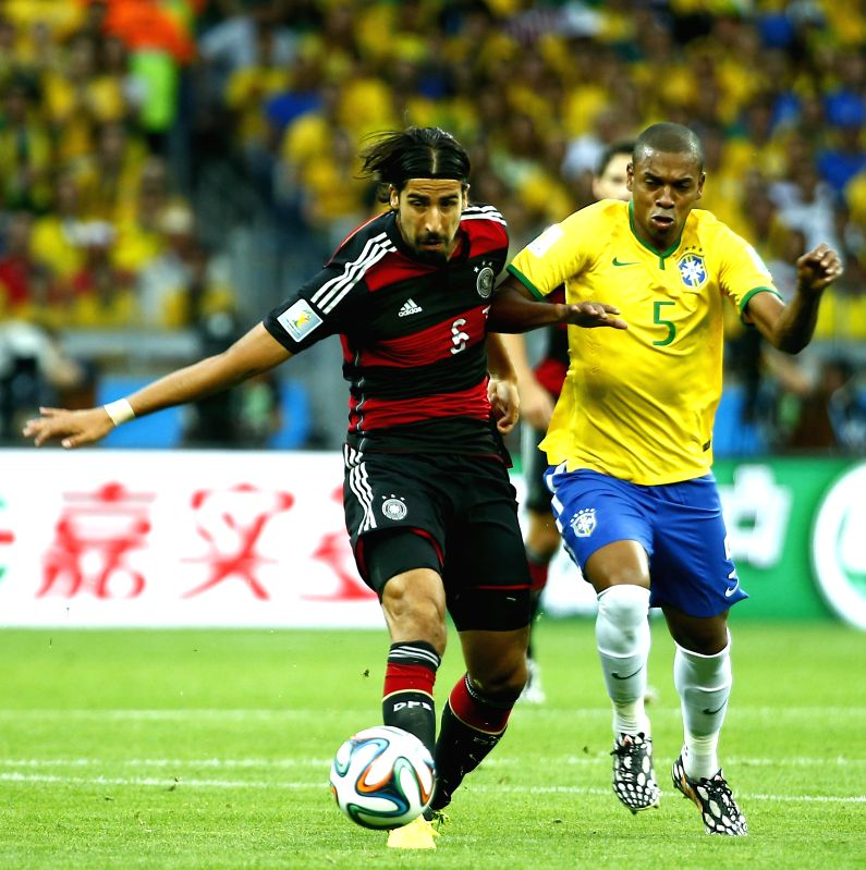 Germany's Sami Khedira (L) vies with Brazil's Fernandinho during a semifinal match between Brazil and Germany of 2014 FIFA World Cup at the Estadio Mineirao ..