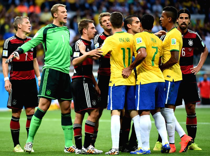 Players of Germany and Brazil argue during a semifinal match between Brazil and Germany of 2014 FIFA World Cup at the Estadio Mineirao Stadium in Belo ...