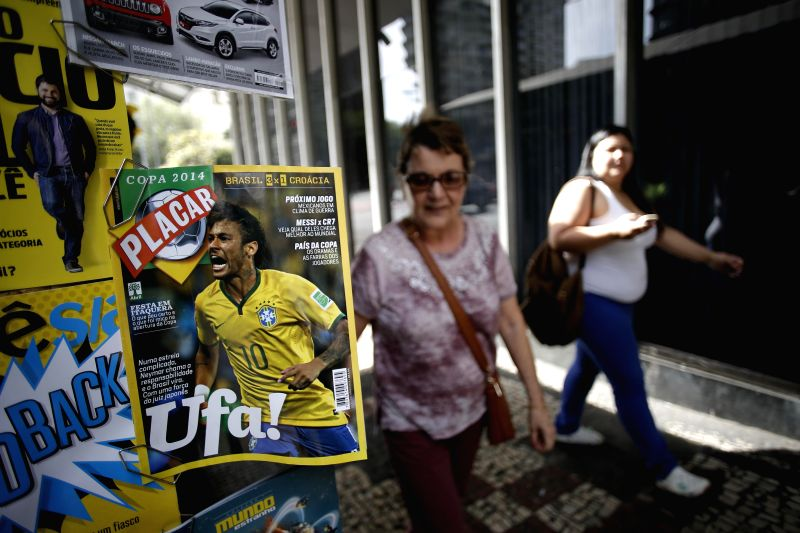 A magazine cover photo of Brazil's Neymar is seen at a news stand in Belo Horizonte, in Brazil, June 19, 2014.