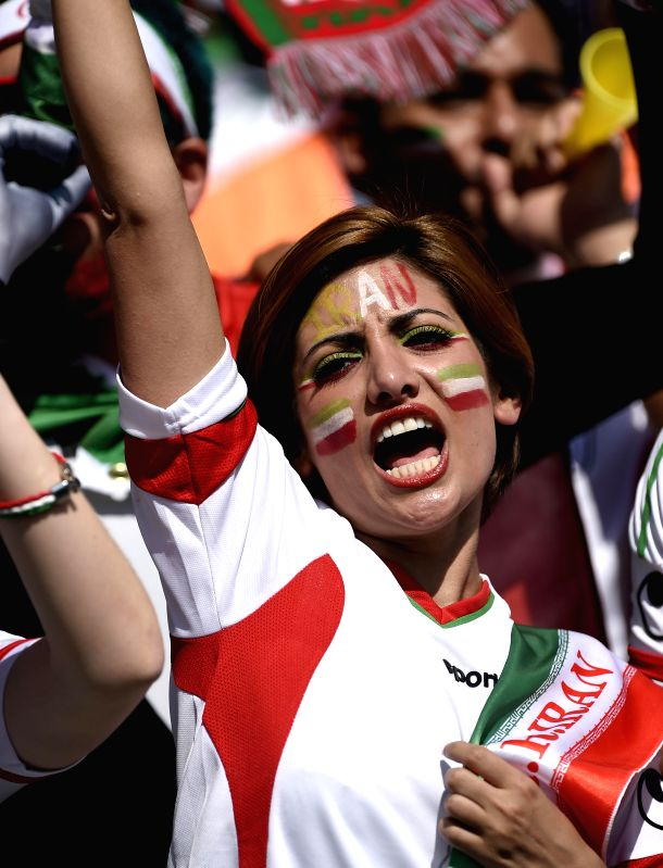 A fan of Iran cheers ahead of a Group F match between Argentina and Iran of 2014 FIFA World Cup at the Estadio Mineirao Stadium in Belo Horizonte, Brazil, ...