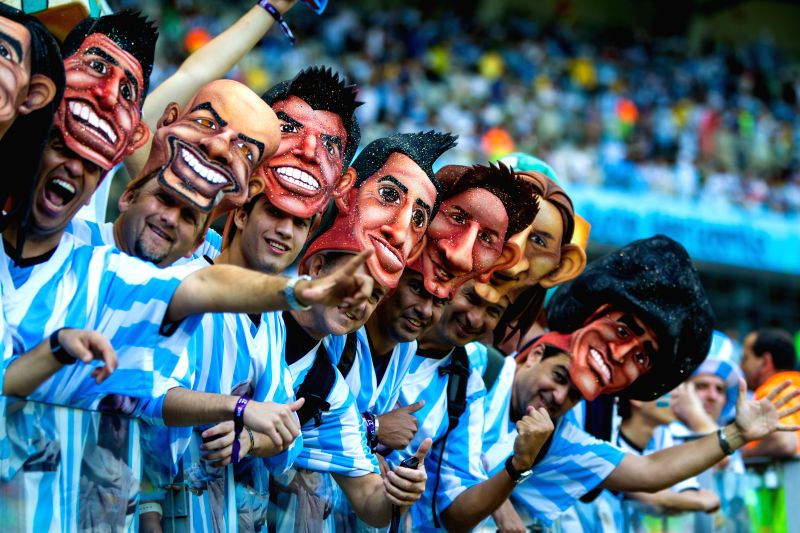 Fans of Argentina cheer for the team ahead of a Group F match between Argentina and Iran of 2014 FIFA World Cup at the Estadio Mineirao Stadium in Belo ...