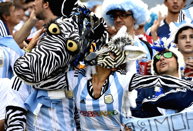 Fans of Argentina cheer ahead of a Group F match between Argentina and Iran of 2014 FIFA World Cup at the Estadio Mineirao Stadium in Belo Horizonte, Brazil,