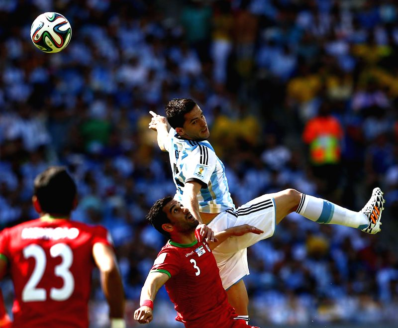Fernando Gago (Top) of Argentina fights for the ball with Ehsan Hajsafi of Iran during a Group F match between Argentina and Iran of 2014 FIFA World Cup at ..