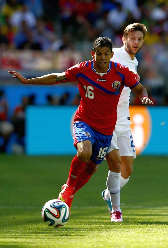 Costa Rica's Christian Gamboa (front) controls the ball during a Group D match between Costa Rica and England of 2014 FIFA World Cup at the Estadio Mineirao .