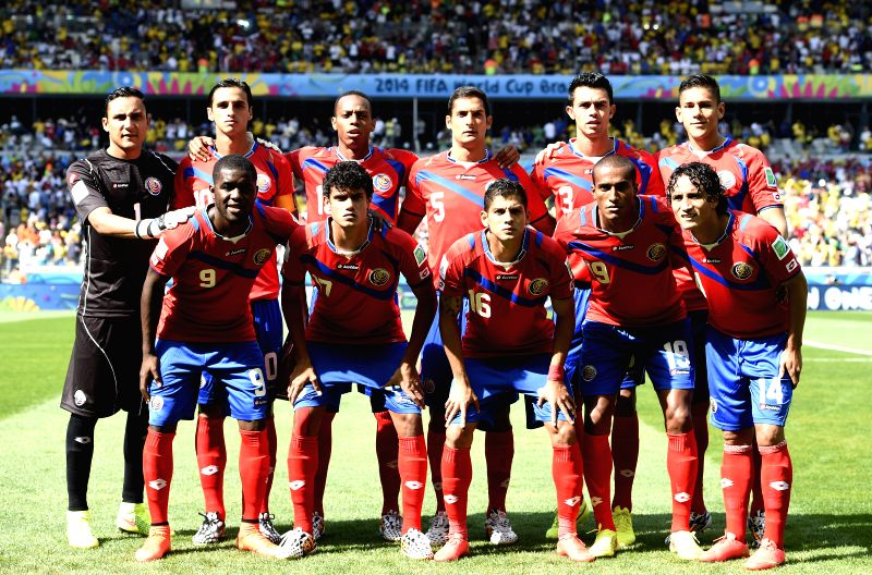 Costa Rica's national team players pose for a group photo before a Group D match between Costa Rica and England of 2014 FIFA World Cup at the Estadio ...