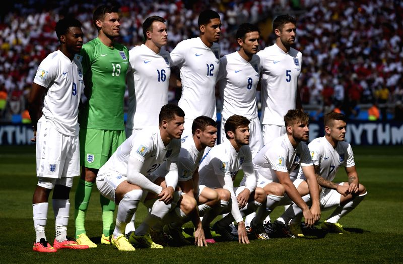 England's national team players pose for a group photo before a Group D match between Costa Rica and England of 2014 FIFA World Cup at the Estadio Mineirao ..