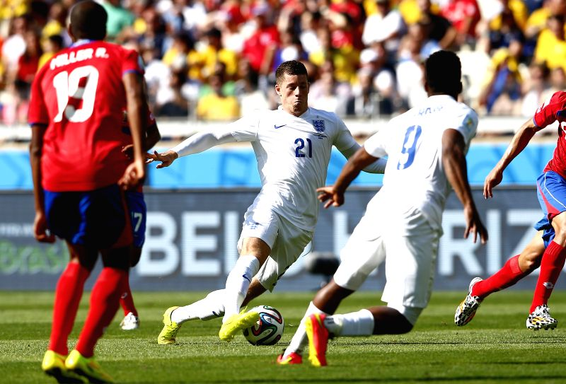 England's Ross Barkely (C) runs with the ball during a Group D match between Costa Rica and England of 2014 FIFA World Cup at the Estadio Mineirao Stadium in ...