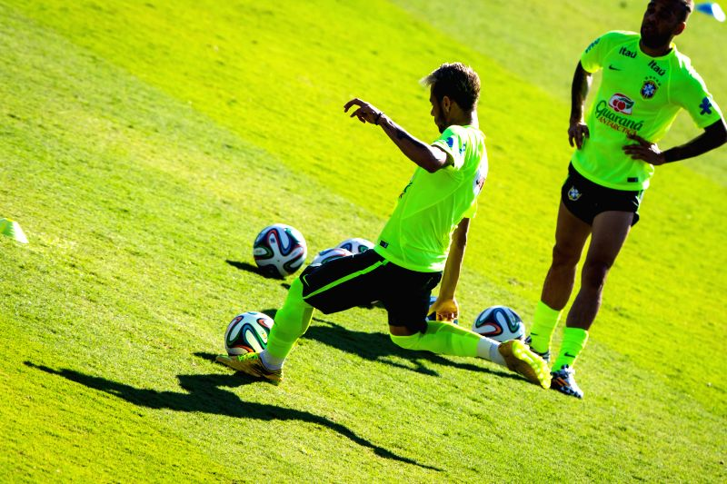 Brazil's Neymar (front) participates in a training session in Belo Horizonte, Brazil, June 27, 2014. Brazil's national football team participated in a ...