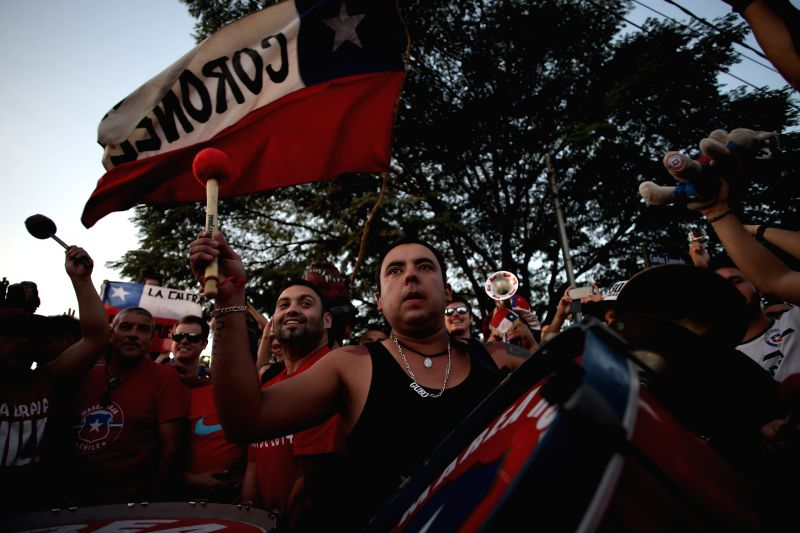 Chile's fans participate in a meeting to support Chile's national football team outside their training camp, in Belo Horizonte, Brazil, June 27, 2014. Chile .