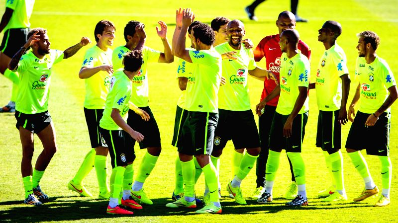 Players of Brazil's national football team cheers during a training session in Belo Horizonte, Brazil, June 27, 2014. Brazil's national football team ...