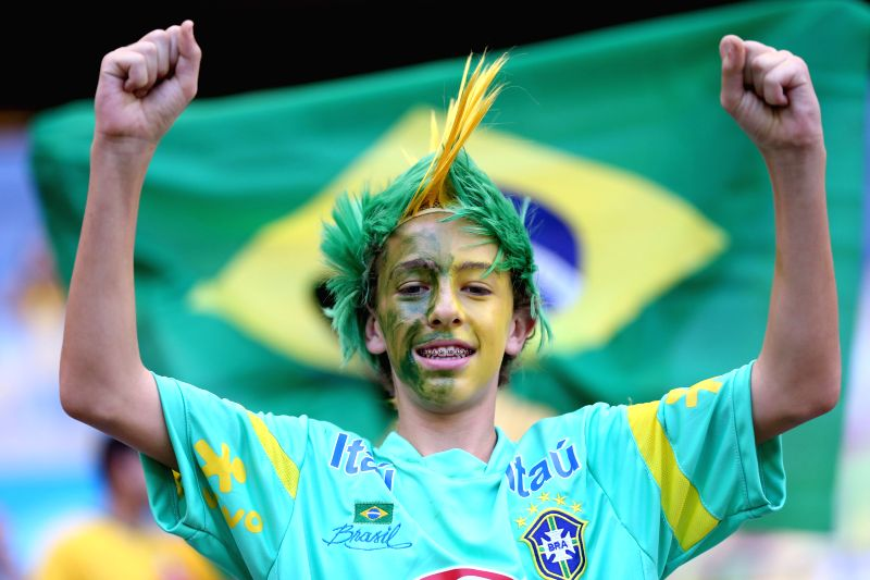 A Brazil's fan poses before a Round of 16 match between Brazil and Chile of 2014 FIFA World Cup at the Estadio Mineirao Stadium in Belo Horizonte, Brazil, on