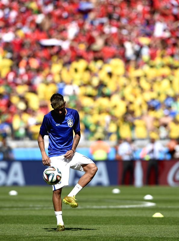 Brazil's Neymar warms up before a Round of 16 match between Brazil and Chile of 2014 FIFA World Cup at the Estadio Mineirao Stadium in Belo Horizonte, ...