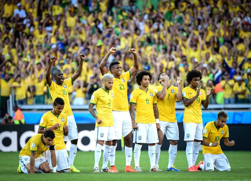 Brazil's players react during the penalty shoot-out of a Round of 16 match between Brazil and Chile of 2014 FIFA World Cup at the Estadio Mineirao Stadium in