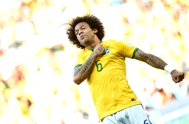 Brazil's Marcelo celebrates a penalty goal during the penalty shoot-out of a Round of 16 match between Brazil and Chile of 2014 FIFA World Cup at the Estadio