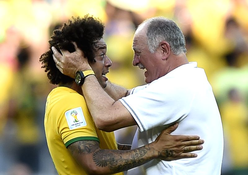 Brazil's coach Luiz Felipe Scolari (R) celebrates the victory with David Luiz after a Round of 16 match between Brazil and Chile of 2014 FIFA World Cup at ...