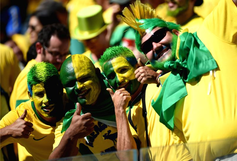 Brazil's fans pose before a Round of 16 match between Brazil and Chile of 2014 FIFA World Cup at the Estadio Mineirao Stadium in Belo Horizonte, Brazil, on ..