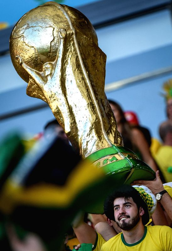 Brazil's fans celebrate the victory after a Round of 16 match between Brazil and Chile of 2014 FIFA World Cup at the Estadio Mineirao Stadium in Belo ...