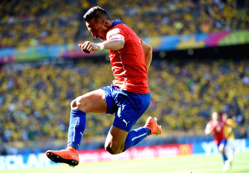 Chile's Alexis Sanchez celebrates the goal during a Round of 16 match between Brazil and Chile of 2014 FIFA World Cup at the Estadio Mineirao Stadium in Belo