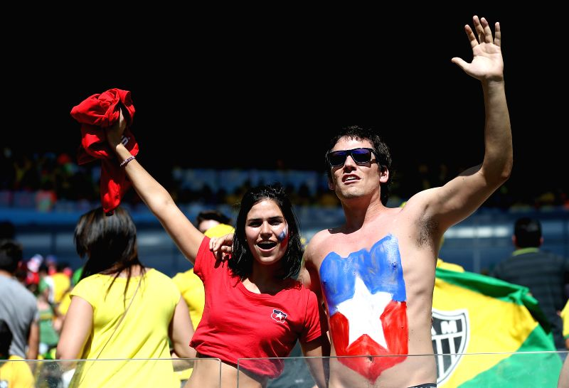 Chile's fans pose before a Round of 16 match between Brazil and Chile of 2014 FIFA World Cup at the Estadio Mineirao Stadium in Belo Horizonte, Brazil, on ...