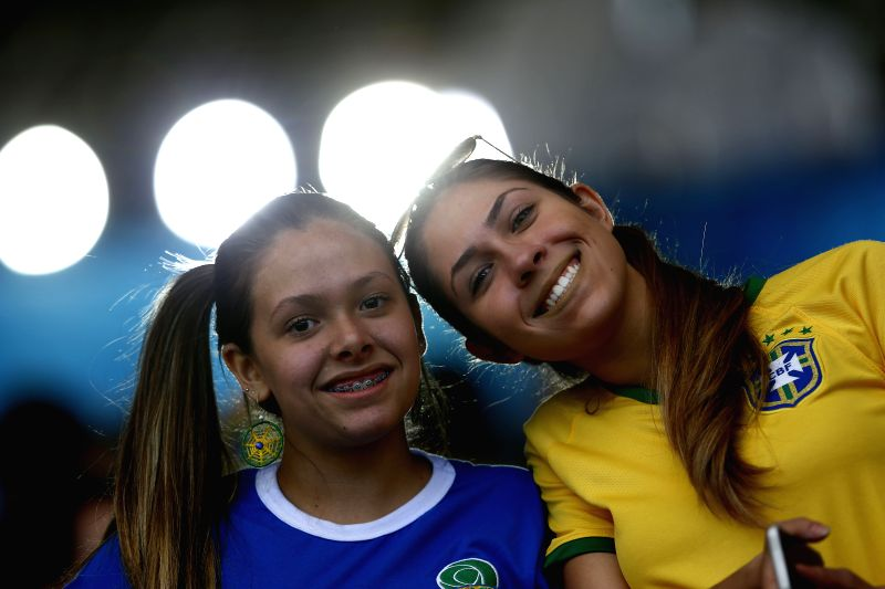 Supporters of Brazil pose before a Round of 16 match between Brazil and Chile of 2014 FIFA World Cup at the Estadio Mineirao Stadium in Belo Horizonte, ...
