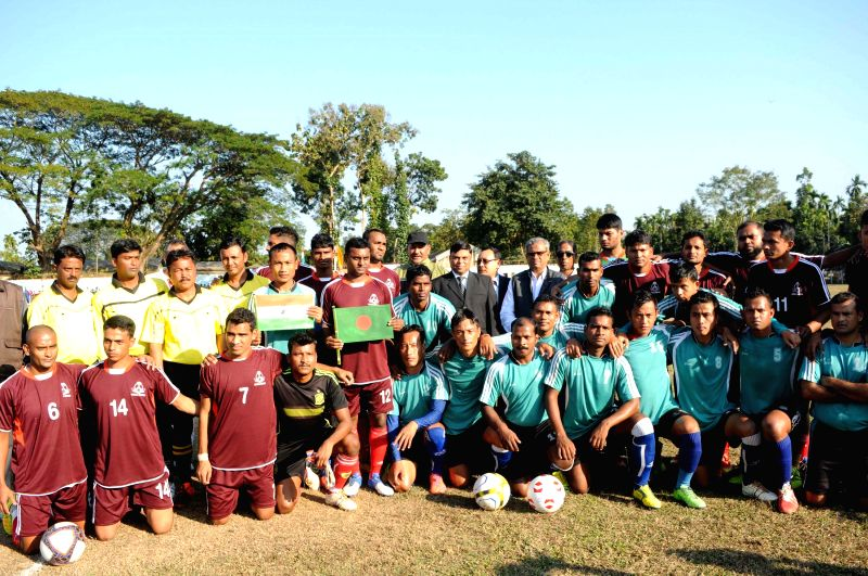 Footballers of BSF and BGB pose for a photograph during a friendly match organised to celebrate the Golden Jubilee Year of BSF in Belonia town in Southern Tripura on Dec 25, 2014.