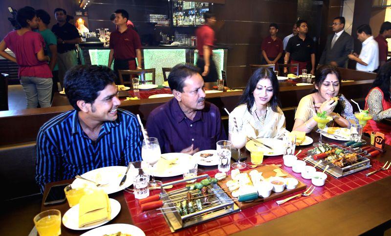 Bengal Ranji cricketer Laxmi Ratan Shukla, former cricketer Sambaran Banerjee, actresses Soumili Sen and Rupa Ganguly during launch of a restaurant in Kolkata on July 22, 2014. - Soumili Sen and Sambaran Banerjee