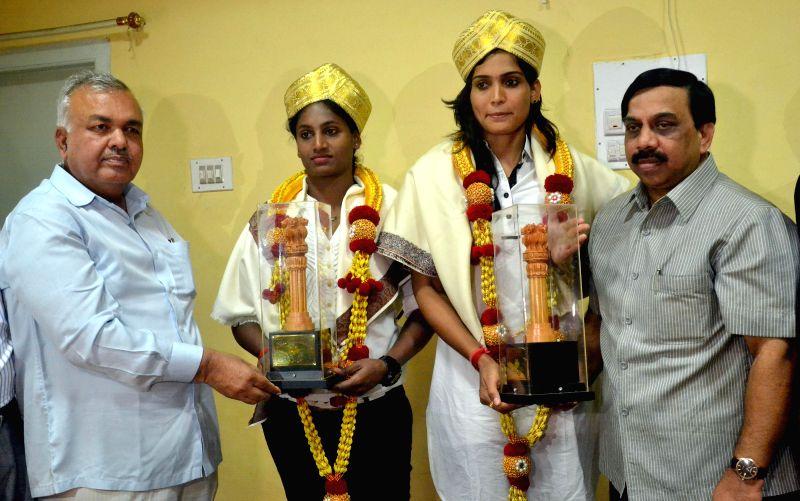 2014 Incheon Asian Games Kabaddi gold medalists  Mamata Poojari and Tejaswini Bai being felicitated by Karnataka Olympic Association president Govindraj in Bengaluru, on Dec 8, 2014.
