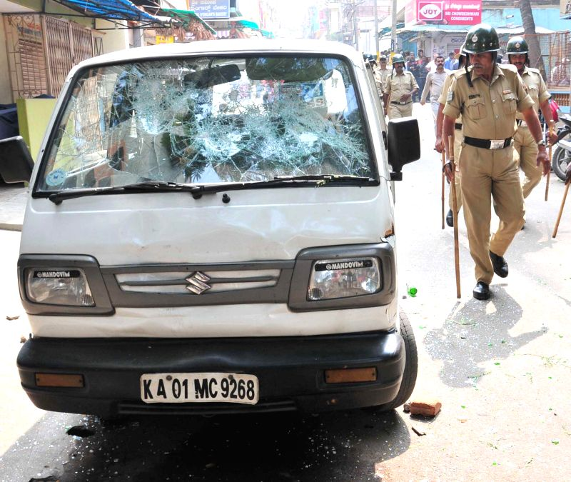 A car that was damaged ​​by people protesting against molestation of a minor by a Bangalore school teacher on Jan 7, 2015.