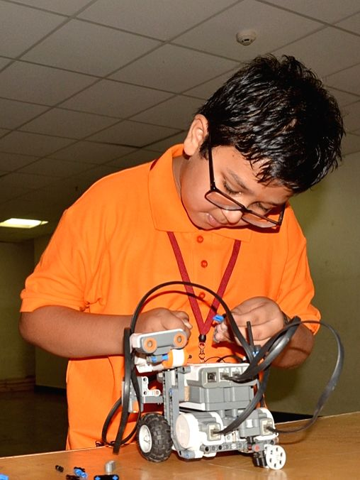 A child busy building a robot during the ROBOFEST 2015 at Jain College in Bengaluru on April 12, 2015.