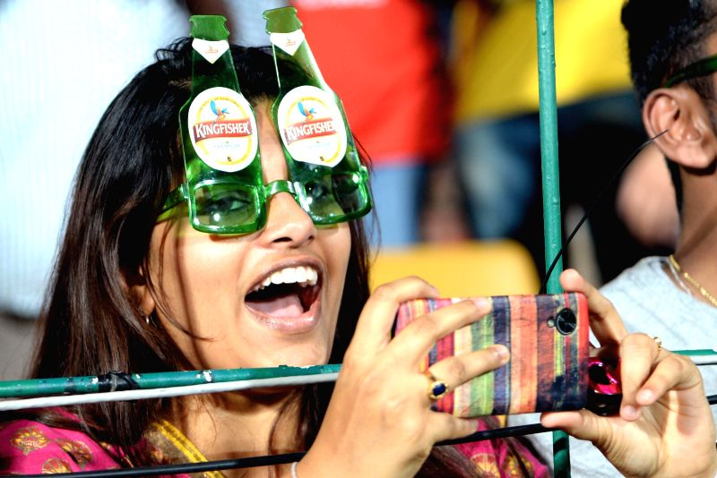 A fan cheers during an IPL-2015 match between Royal Challengers Bangalore and Mumbai Indians at M Chinnaswamy Stadium, in Bengaluru, on April 19, 2015.