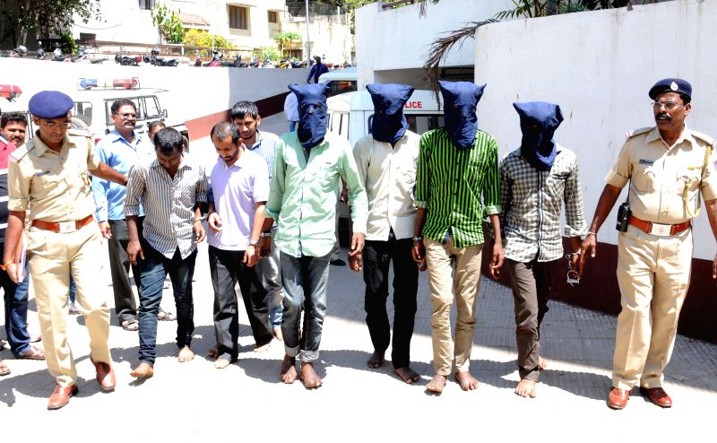 A ganng of contract killers being taken to be produced during a press conference at Police Commissioners' office, in Bengaluru on March 11, 2015.