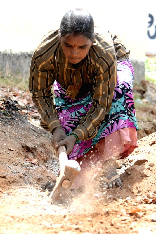 A lady seen working at a construction site in Bengaluru, on March 8, 2015. The world is celebrating International Women's Day today.