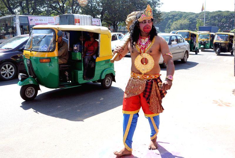 A man disguises as lord Hanuman on Hanuman Jayanti, in Bengaluru, on Dec 4, 2014.